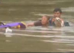 woman and dog saved from flood