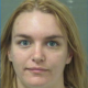 Woman arrested after chained dog found in car