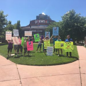 Supporters of Baby protest outside a local news station.
