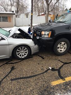Distracted driver plows into patrol vehicle