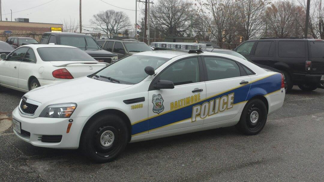 Smashed-in car resembling Baltimore city police cruiser ...