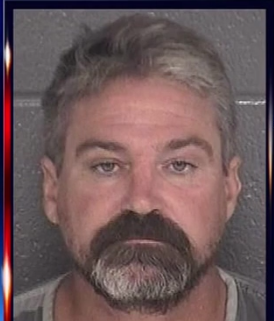Man accused of killing dog and neighbor over dog poop