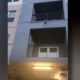 Dog dangles from apartment balcony