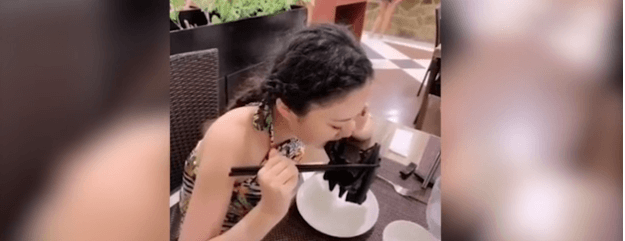 A woman consumes bat soup in China