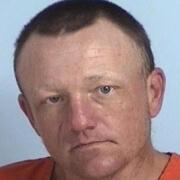 Man accused of hitting dog