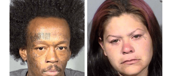 Couple charged after dead pit bull found tied to fence