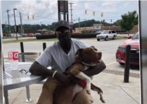 Strangers help homeless man and dog
