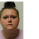 Woman faces 79 charges after malnourished and dead dogs found