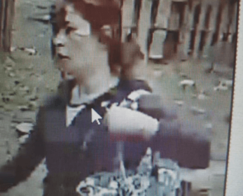 Woman caught on video beating and biting dog